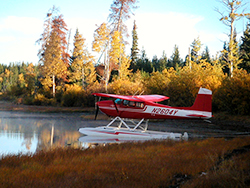 Floatplane parked on a remote fly in lake
